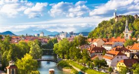 A pleasure boat floats along the the Ljubljanska in Ljubljana, Slovenia – Shutterstock