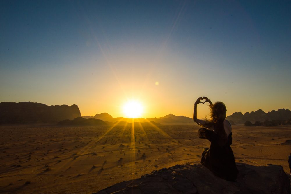 The sun falls behind the mountains in the desert – Ben Finch of Wadi Rum, in Jordan – Ben Finch