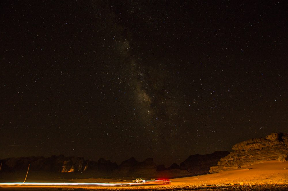 The Milky Way twinkles above camp as Ahmad returns from evening prayers, in Wadi Rum, Jordan – Ben Finch