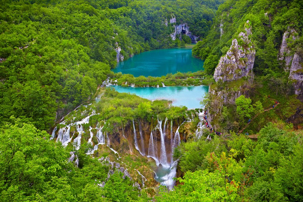Plitvice is a series of cool, clear, blue lakes connected by stunning waterfalls – Shutterstock