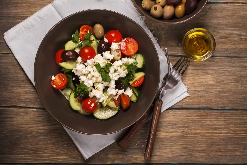 Tomatoes, olives, cucumber, feta and olive oil make the perfect Greek Salad – Shutterstock vegetarian