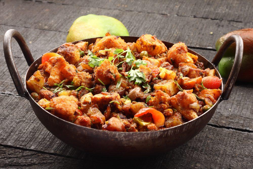 Aloo gobi, or potato and cauliflower curry, is an Indian staple – Shutterstock vegetarian