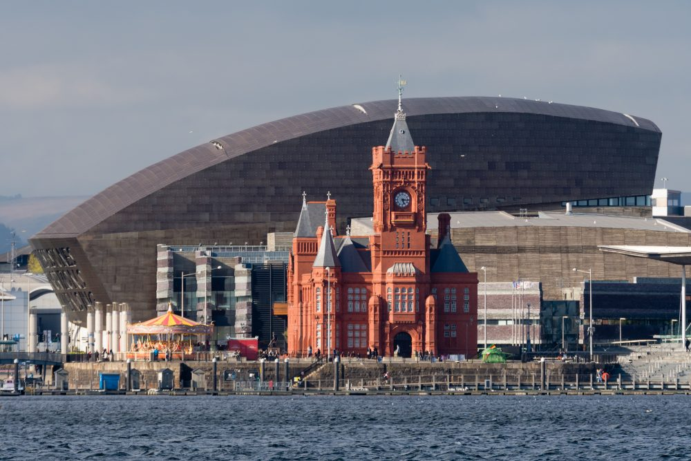The Millennium Centre and National Assembly for Wales are seen across Cardiff Bay – Shutterstock