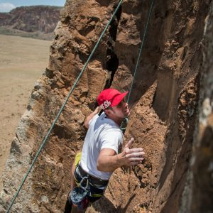 David Pal looks for a hold while climbing the Main Wall in the Hell's Gate National Park – Nathan Siegel Hell's gate