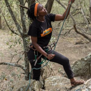 Naomi Kamau works as an instructor at BlueSky Kenya. Here she belays a climber on Fischer's Tower - Nathan Siegel Hell's gate