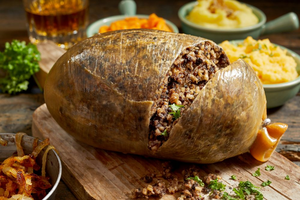 The Scotish national dish  is combination of sheep's heart, liver and lungs, onion, oatmeal, spices and stock, encased in a sheep's stomach — Shutterstock