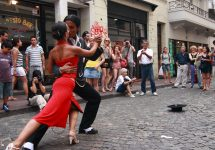 A pair of tango dancers performing in the streets of Buenos Aires — gary yim / Shutterstock