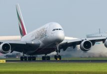 A Emirates Airlines Airbus A380 is taking off from the airport — verzellenberg / Shutterstock