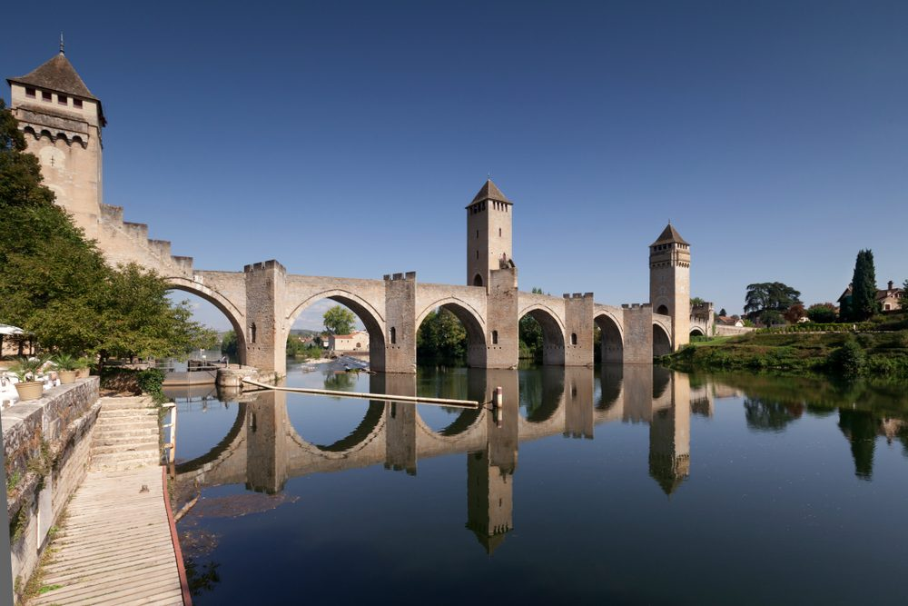 Pont Valentré has six Gothic arches and three square bridge towers — Shutterstock