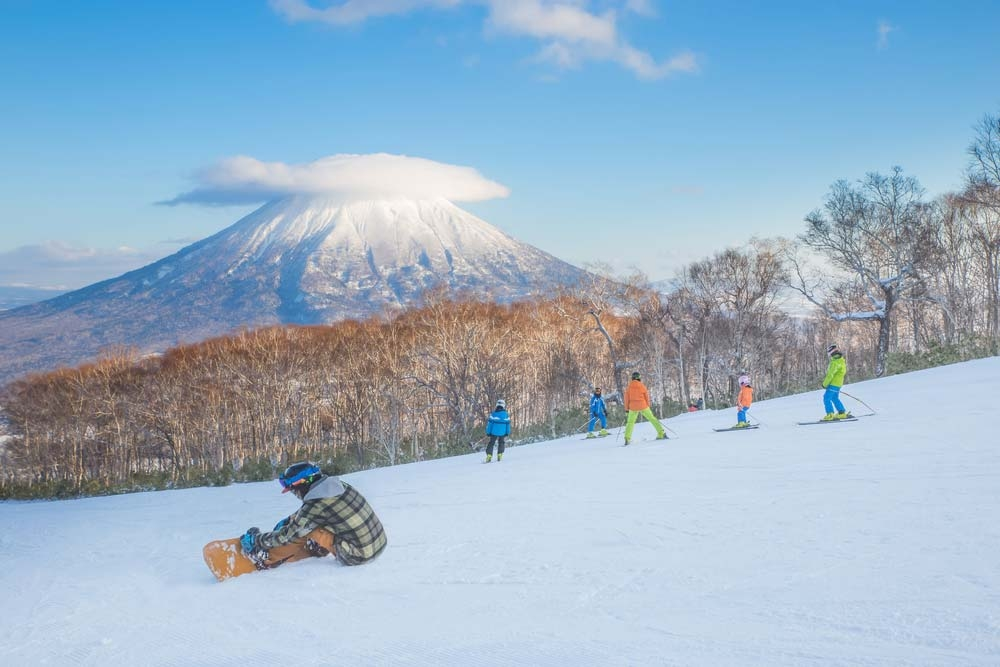 In recent years, Japan is becoming a popular first choice for skiers from all over the world. This is Mt Yotei in Niseko Ski area — Shutterstock 6 best places to travel in December 2019