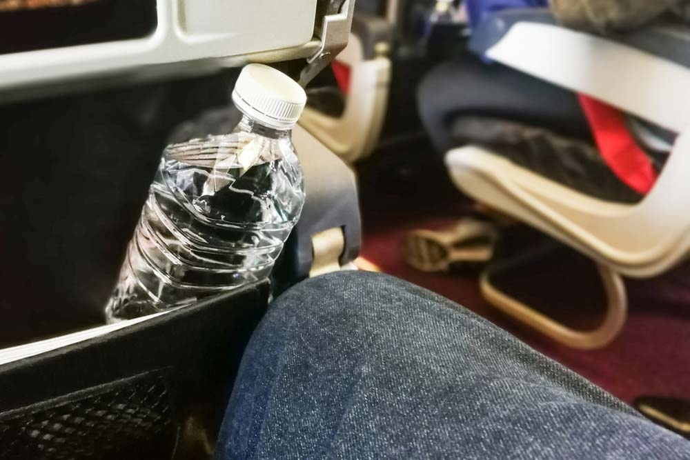No one really knows when and how often water tanks on a plane get cleaned. Bring your own (reusable) water bottle — Shutterstock