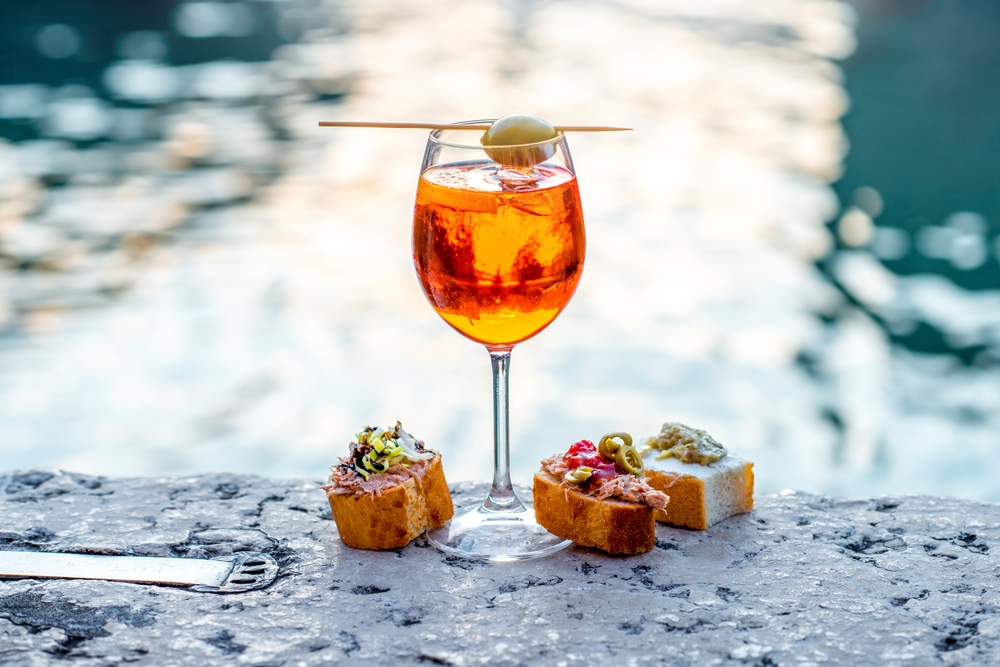Venetians eat often eaten Cicchetti outside with a drink in their hands while passionately discussing various topics — Shutterstock Venice: the most beautiful stopover you'll ever have