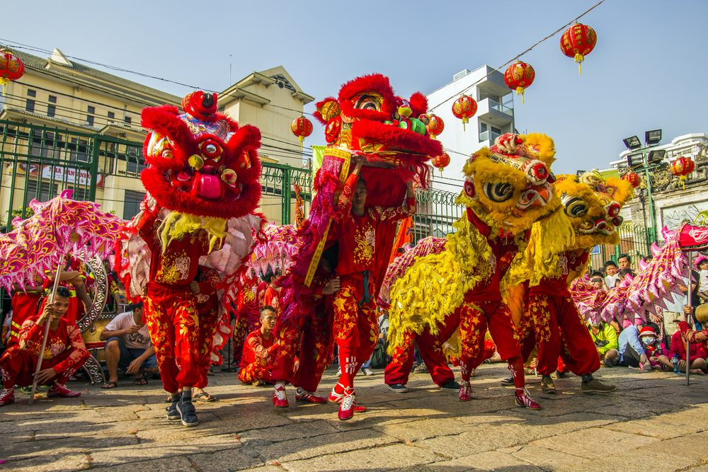 Tết celebrations feature dragon processions, music performances, color and flavor in excess, and at midnight on Tết eve a countdown and fireworks — Saigoneer / Shutterstock 6 destinations to travel in January