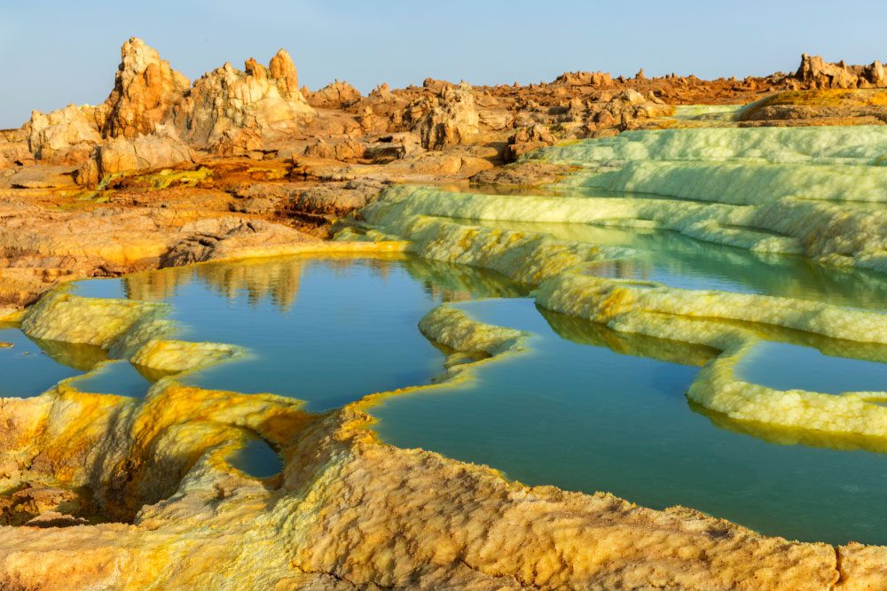 The beauty of Dallol lies in its other-worldly appearance with salt-pillars geysers, flower-like crusts and crystals — Shutterstock